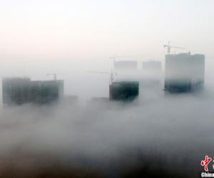 贵州省安顺出现平流雾奇观市区宛如仙境(组图)
